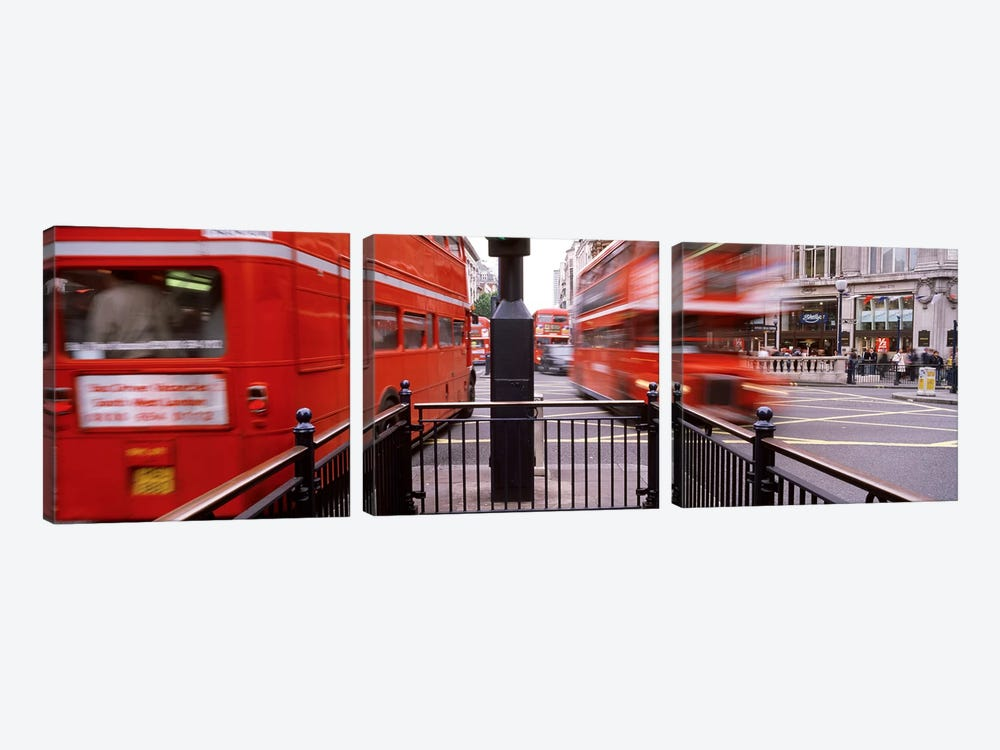 Blurred Motion View Of Double-Decker Buses, Oxford Circus Station Circle, London, England by Panoramic Images 3-piece Canvas Wall Art