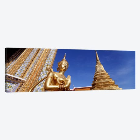 Low angle view of a statueWat Phra Kaeo, Grand Palace, Bangkok, Thailand Canvas Print #PIM4341} by Panoramic Images Canvas Artwork