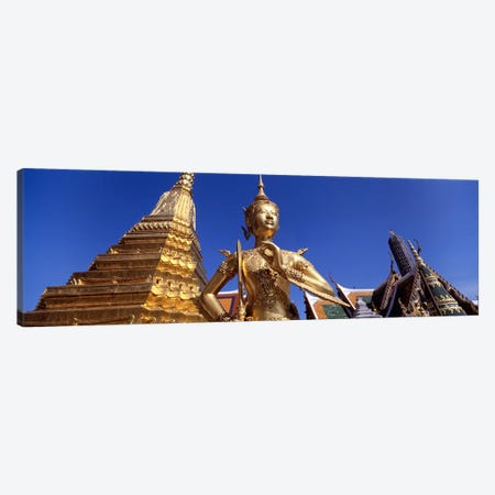 Low angle view of a statueWat Phra Kaeo, Grand Palace, Bangkok, Thailand Canvas Print #PIM4343} by Panoramic Images Canvas Wall Art