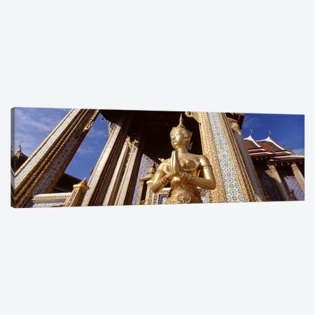 Low angle view of a statueWat Phra Kaeo, Grand Palace, Bangkok, Thailand Canvas Print #PIM4344} by Panoramic Images Art Print