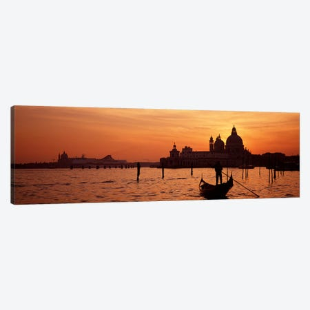 Santa Maria della Salute With A Gondoleer And His Boat On The Grand Canal In The Foreground, Venice, Italy Canvas Print #PIM4356} by Panoramic Images Canvas Artwork