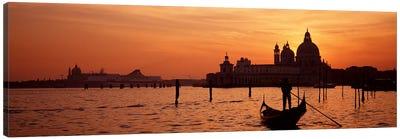 Silhouette of a person on a gondola with a church in background, Santa Maria Della Salute, Grand Canal, Venice, Italy Canvas Print #PIM4356
