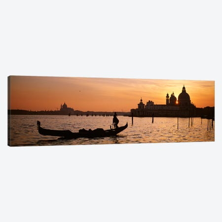 Silhouette of a gondola in a canal at sunset, Santa Maria Della Salute, Venice, Italy Canvas Print #PIM4361} by Panoramic Images Canvas Art