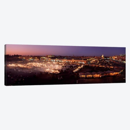 High angle view of a market lit up at dusk, Djemaa El Fna, Medina Quarter, Marrakesh, Morocco Canvas Print #PIM4382} by Panoramic Images Canvas Artwork