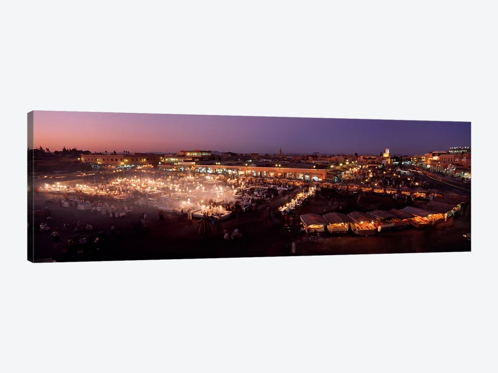 High angle view of a market lit up at dusk, Djemaa El Fna, Medina Quarter, Marrakesh, Morocco by Panoramic Images 1-piece Canvas Artwork