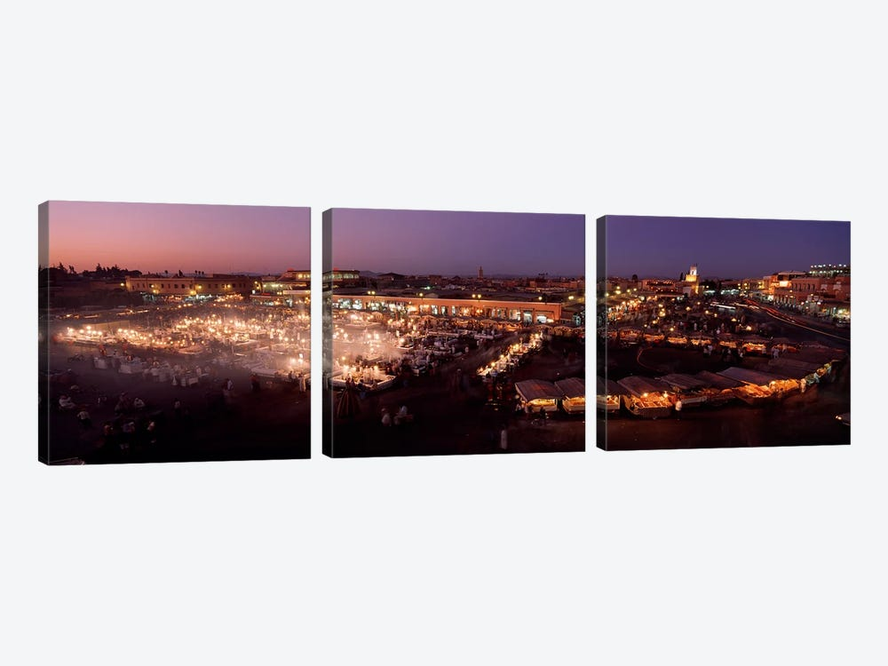 High angle view of a market lit up at dusk, Djemaa El Fna, Medina Quarter, Marrakesh, Morocco by Panoramic Images 3-piece Canvas Artwork