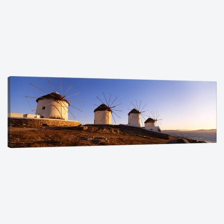 Low angle view of traditional windmills, Mykonos, Cyclades Islands, Greece Canvas Print #PIM4444} by Panoramic Images Canvas Art