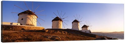 Low angle view of traditional windmills, Mykonos, Cyclades Islands, Greece Canvas Art Print