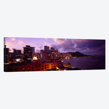 Buildings lit up at dusk, Waikiki, Oahu, Hawaii, USA Canvas Print #PIM4492} by Panoramic Images Canvas Wall Art