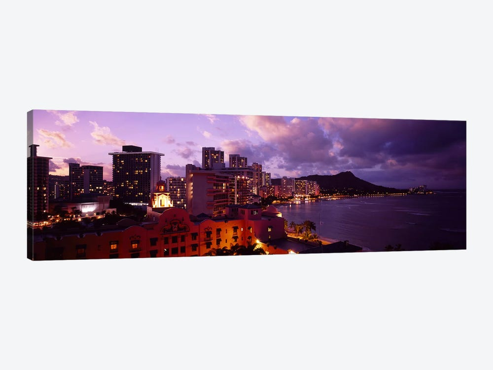 Buildings lit up at dusk, Waikiki, Oahu, Hawaii, USA by Panoramic Images 1-piece Canvas Artwork