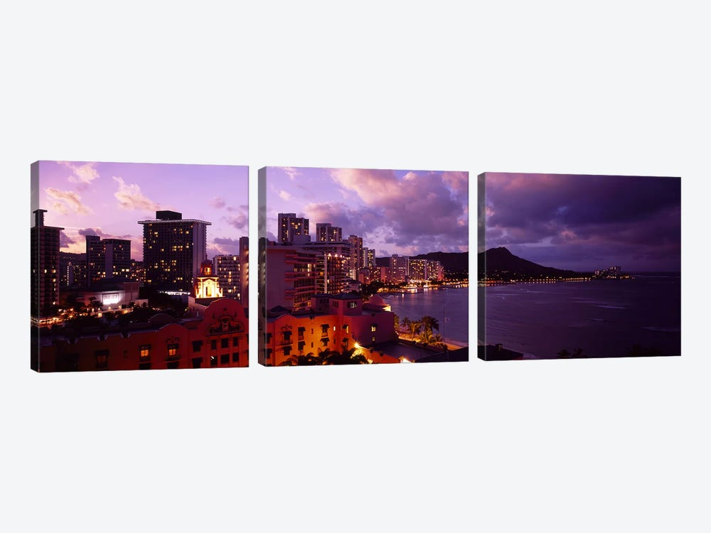 Buildings lit up at dusk, Waikiki, Oahu, Hawaii, USA by Panoramic Images 3-piece Canvas Art