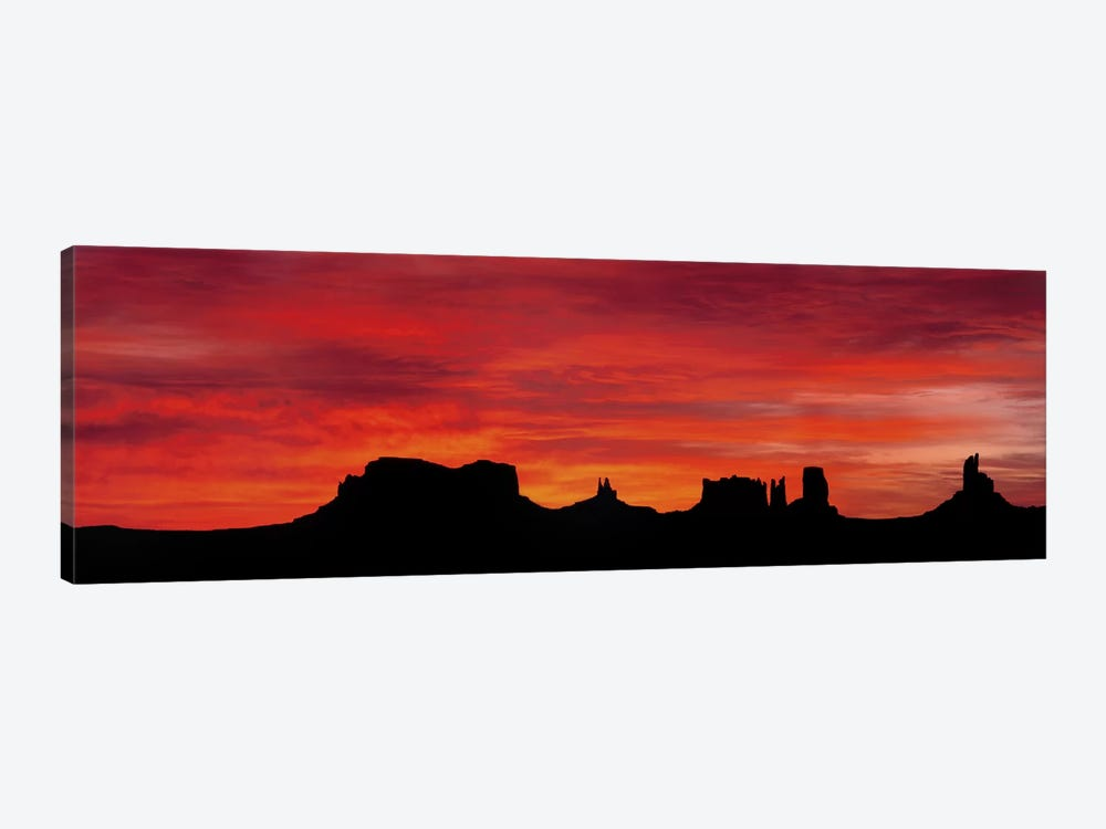 Silhouette Of Monument Valley's Buttes Across A Deep Orange Sunset by Panoramic Images 1-piece Canvas Wall Art