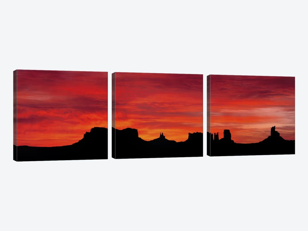 Silhouette Of Monument Valley's Buttes Across A Deep Orange Sunset by Panoramic Images 3-piece Canvas Art