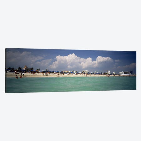 Tourists on the beach, Miami, Florida, USA Canvas Print #PIM4595} by Panoramic Images Canvas Art