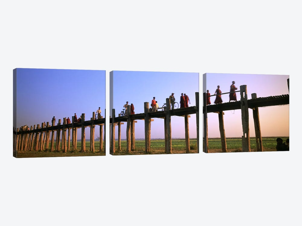 Myanmar, Mandalay, U Bein Bridge, People crossing over the bridge by Panoramic Images 3-piece Canvas Artwork