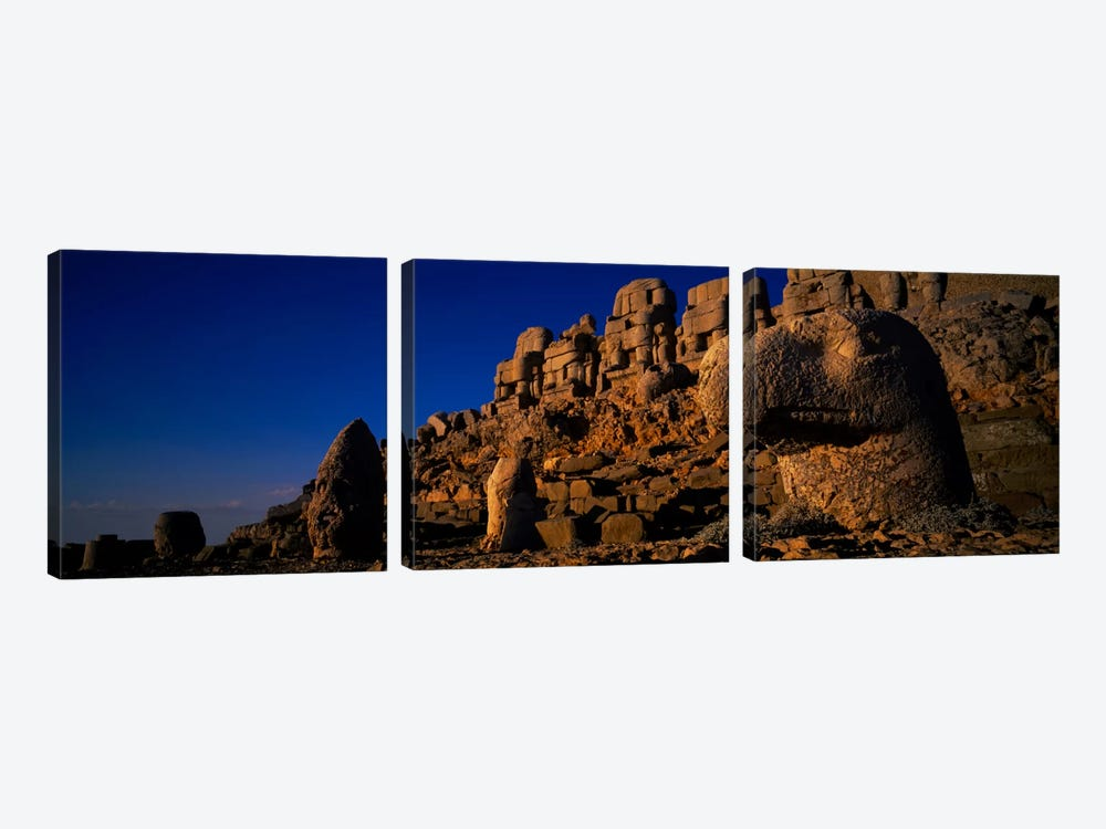 Rocks on a cliff, Mount Nemrut, Nemrud Dagh, Cappadocia, Antolia, Turkey by Panoramic Images 3-piece Canvas Art Print