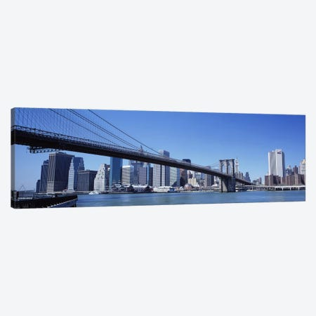 USA, New York State, New York City, Brooklyn Bridge, Skyscrapers in a city Canvas Print #PIM4678} by Panoramic Images Canvas Artwork