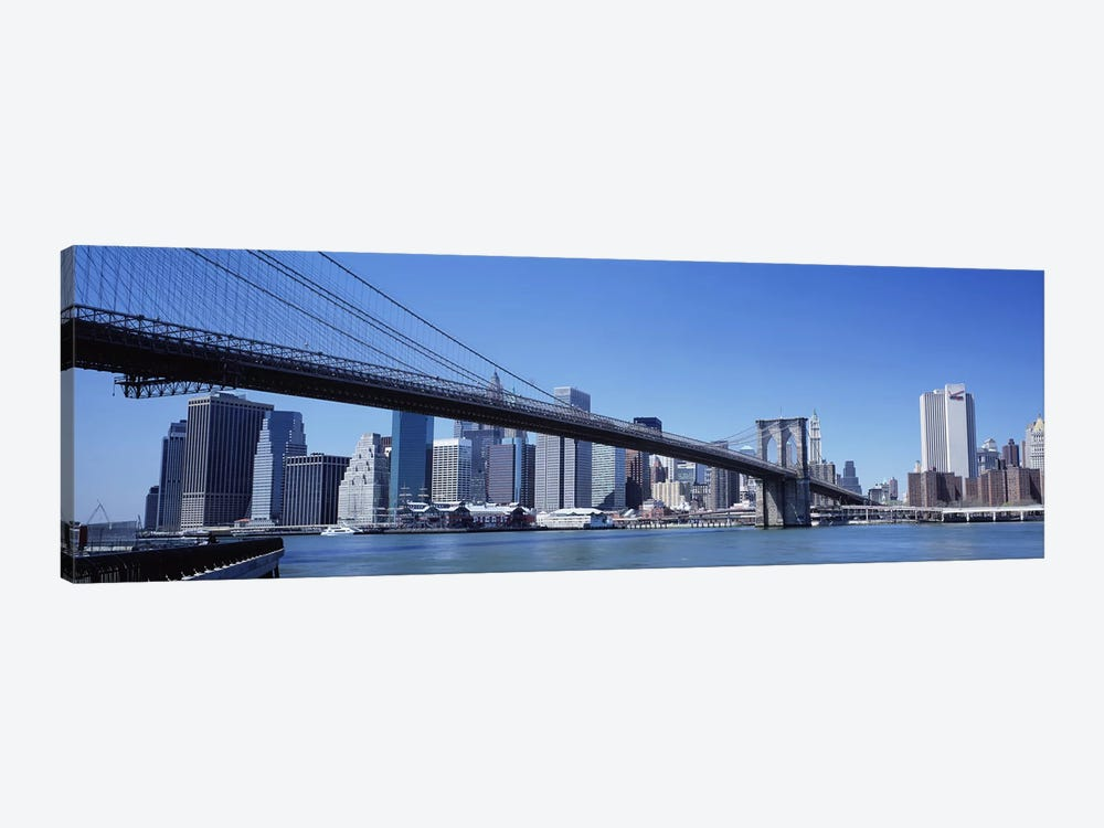 USA, New York State, New York City, Brooklyn Bridge, Skyscrapers in a city by Panoramic Images 1-piece Art Print