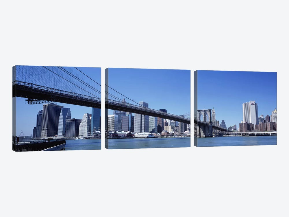 USA, New York State, New York City, Brooklyn Bridge, Skyscrapers in a city by Panoramic Images 3-piece Art Print