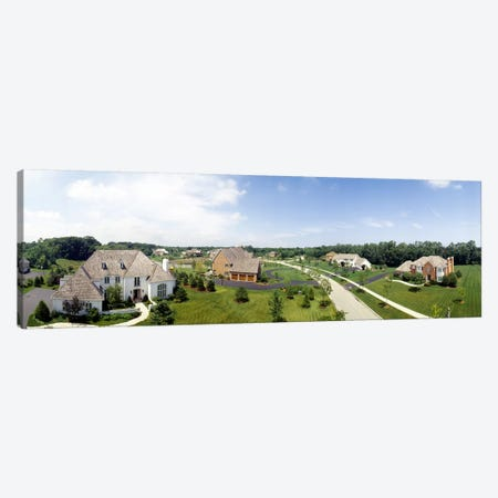 High angle view of houses on a field Canvas Print #PIM4747} by Panoramic Images Art Print
