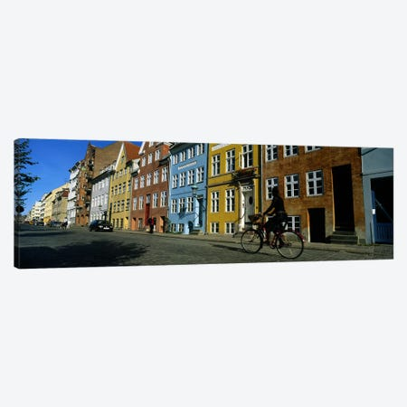 Woman Riding A Bicycle, Copenhagen, Denmark Canvas Print #PIM4764} by Panoramic Images Art Print