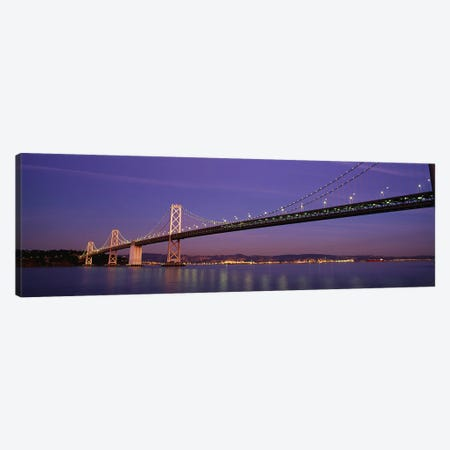 Low angle view of a bridge at dusk, Oakland Bay Bridge, San Francisco, California, USA Canvas Print #PIM4825} by Panoramic Images Canvas Art