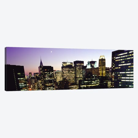 Buildings lit up at dusk, Manhattan, New York City, New York State, USA Canvas Print #PIM4826} by Panoramic Images Canvas Art