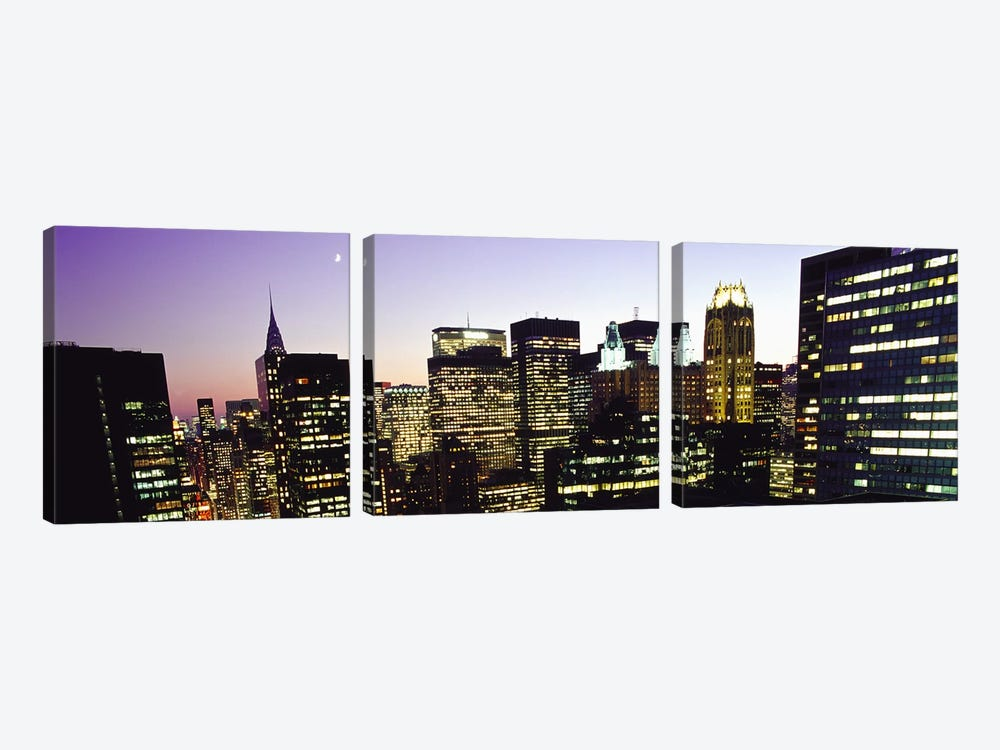 Buildings lit up at dusk, Manhattan, New York City, New York State, USA by Panoramic Images 3-piece Art Print