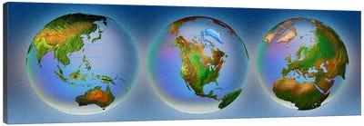 Close-up of three globes Canvas Art Print