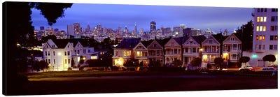 Buildings Lit Up At Dusk, Alamo Square, San Francisco, California, USA Canvas Print #PIM4968