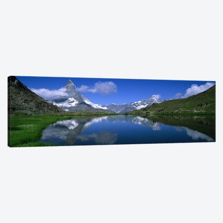 A Snow-Covered Matterhorn And Its Reflection In Riffelsee, Pennine Alps, Switzerland Canvas Print #PIM5050} by Panoramic Images Canvas Art Print