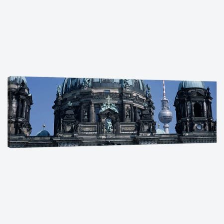 Low angle view of a church, Berliner Dom, with Television Tower (Fernsehturm) in distance, Berlin, Germany Canvas Print #PIM5068} by Panoramic Images Canvas Artwork