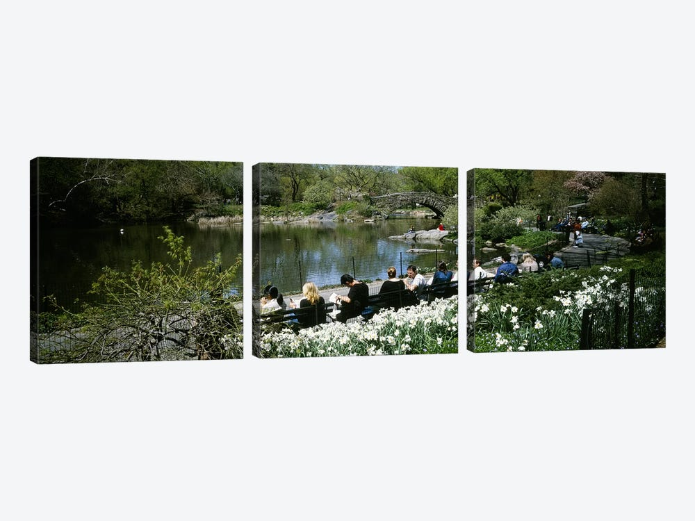 Group of people sitting on benches near a pond, Central Park, Manhattan, New York City, New York State, USA by Panoramic Images 3-piece Art Print