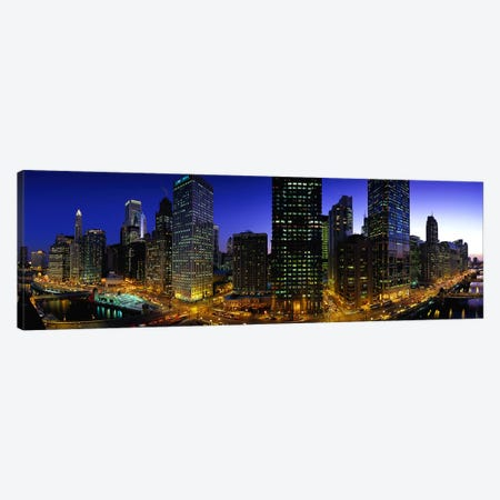 Buildings lit up at duskChicago, Illinois, USA Canvas Print #PIM5207} by Panoramic Images Canvas Art Print