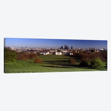 Distant View Of Canary Wharf On The Isle Of Dogs From Greenwich Park, London, England Canvas Print #PIM5226} by Panoramic Images Canvas Art Print