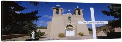 Cross in front of a church, San Francisco de Asis Church, Ranchos De Taos, New Mexico, USA Canvas Print #PIM5248