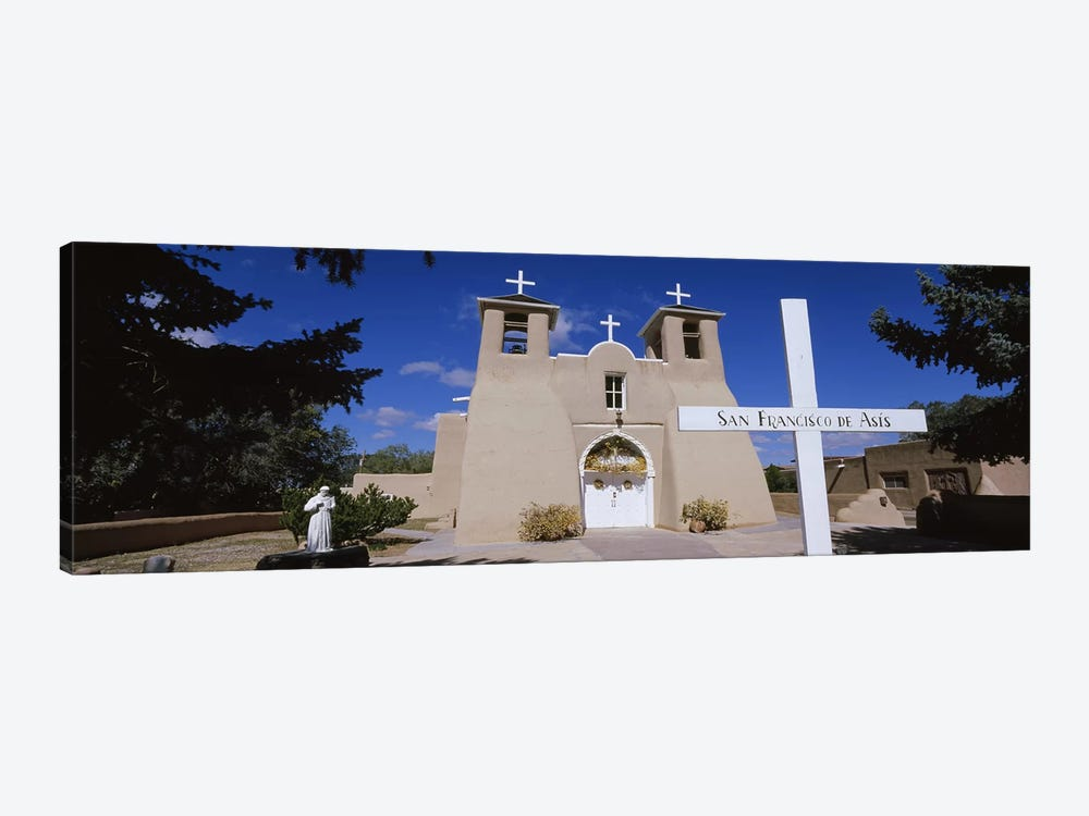 Cross in front of a church, San Francisco de Asis Church, Ranchos De Taos, New Mexico, USA by Panoramic Images 1-piece Art Print