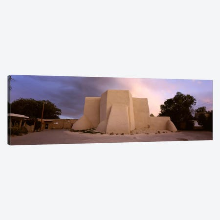 Overcast clouds sky over a church, San Francisco de Asis Church, Ranchos De Taos, New Mexico, USA Canvas Print #PIM5250} by Panoramic Images Art Print