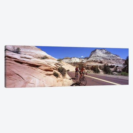 Two people cycling on the road, Zion National Park, Utah, USA Canvas Print #PIM5312} by Panoramic Images Canvas Artwork