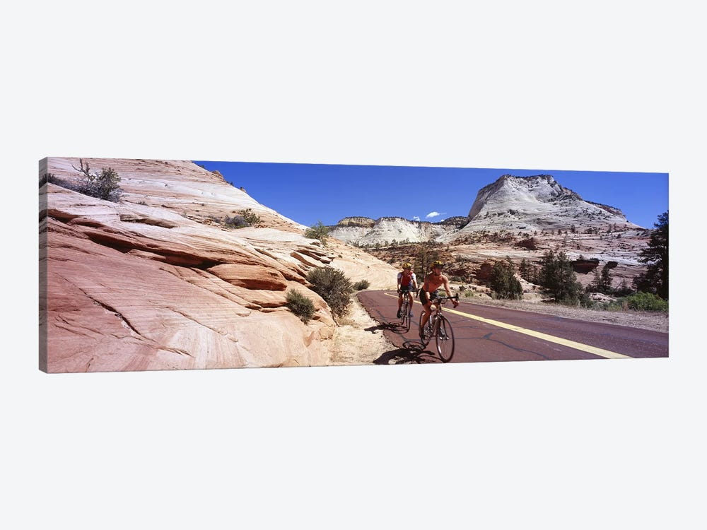 Two people cycling on the road, Zion National Park, Utah, USA by Panoramic Images 1-piece Canvas Print