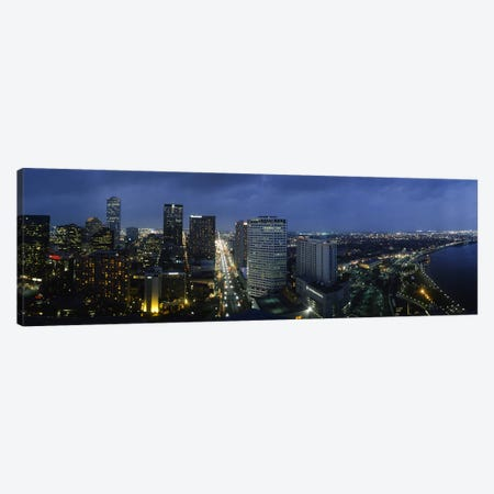 High angle view of buildings in a city lit up at night, New Orleans, Louisiana, USA Canvas Print #PIM5317} by Panoramic Images Canvas Art Print