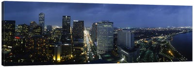 High angle view of buildings in a city lit up at night, New Orleans, Louisiana, USA Canvas Art Print