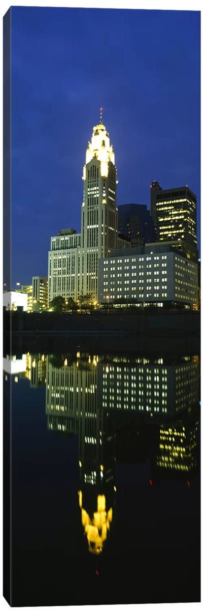 Buildings in a city lit up at night, Scioto River, Columbus, Ohio, USA Canvas Art Print
