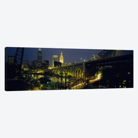 Arch bridge & buildings lit up at nightCleveland, Ohio, USA 3-Piece Canvas #PIM5355} by Panoramic Images Canvas Print