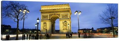 Tourists walking in front of a monument, Arc de Triomphe, Paris, France Canvas Print #PIM5387