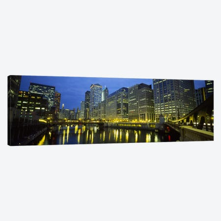 Low angle view of buildings lit up at night, Chicago River, Chicago, Illinois, USA Canvas Print #PIM5451} by Panoramic Images Canvas Print