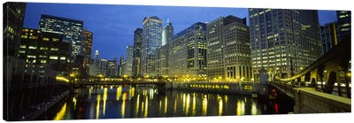 Low angle view of buildings lit up at night, Chicago River, Chicago, Illinois, USA Canvas Print #PIM5451