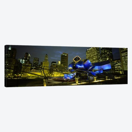 Low angle view of buildings lit up at night, Pritzker Pavilion, Millennium Park, Chicago, Illinois, USA Canvas Print #PIM5452} by Panoramic Images Canvas Art Print