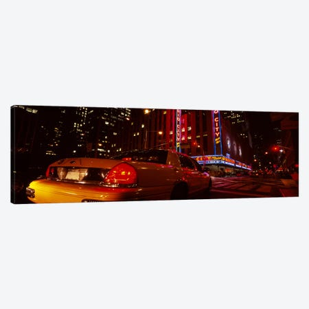 Car on a road, Radio City Music Hall, Rockefeller Center, Manhattan, New York City, New York State, USA Canvas Print #PIM5455} by Panoramic Images Canvas Wall Art