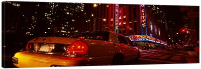 Car on a road, Radio City Music Hall, Rockefeller Center, Manhattan, New York City, New York State, USA Canvas Art Print